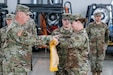 Command Sgt. Maj. Duane Hedrick, command sergeant major of the 652nd Regional Support Group, left, and Col. Erica Herzog, the commander of the 652nd RSG, case the unit colors during  the Relief in Place/Transfer of Authority ceremony July 8 in the hangar of the Powidz Air Base, Powidz, Poland. During the ceremony, the 652nd RSG, an Army Reserve unit out of Helena, Montana, transferred authority of the 11 base camps they conducted base operations for across Poland to the 297th RSG, a National Guard unit from Alaska. (U.S. Army Reserve photo by Master Sgt. Ryan Matson, 652nd Regional Support Group)