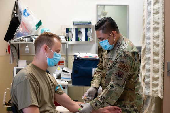 Airmen demonstrate a serology test at Creech Air Force Base.