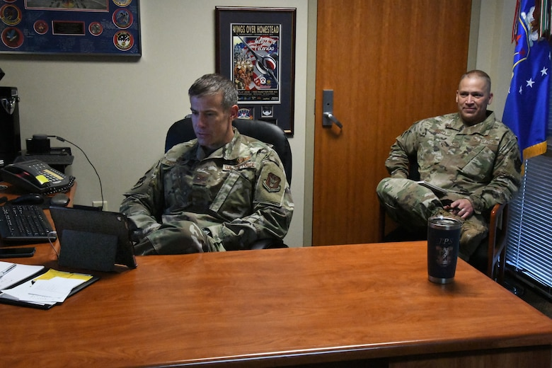 Col. Sean Carpenter, 926th Wing commander, and Chief Master Sgt. Jeffrey Scott, 926th Wing command chief, hosted the wing's first town hall meeting discussing racial disparity on July 11, 2020, Nellis Air Force Base, Nevada.  Due to COVID-19 restrictions, the meeting was held virtually through Zoom and included an anonymous question and answer portion utilizing a tab on the Air Force Connect app. (U.S. Air Force photo by Staff Sgt. Paige Yenke)