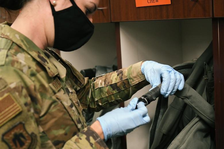 Airman inspects G-Suit