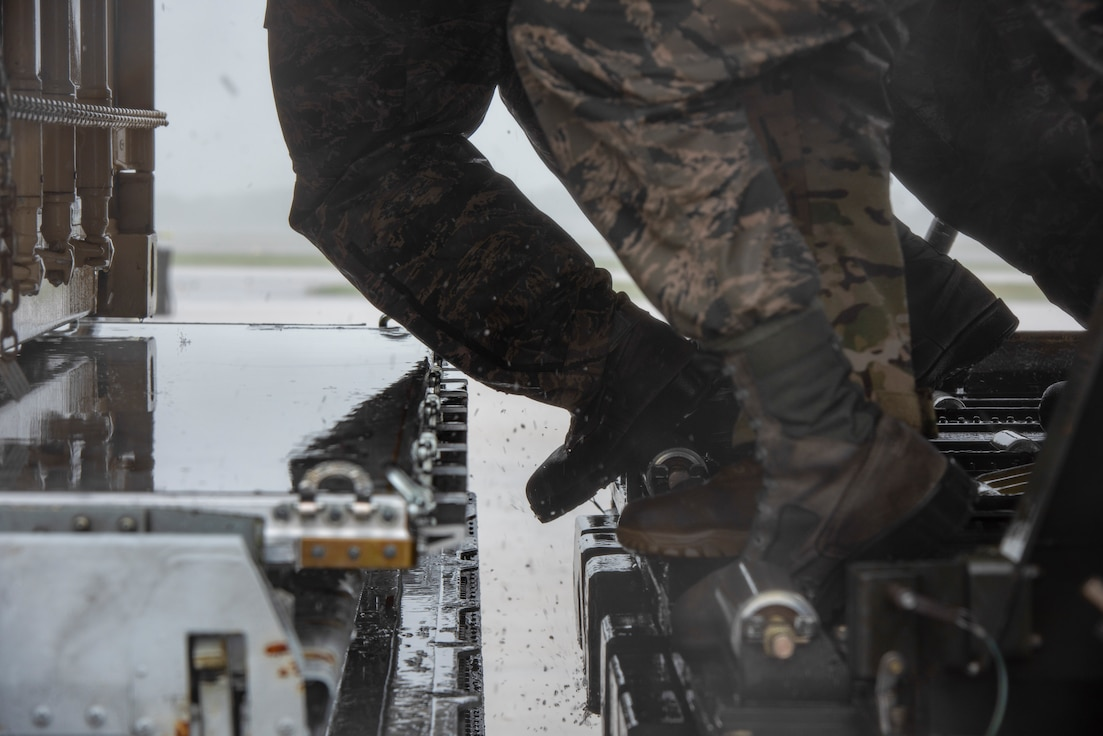 Dover AFB continues its rapid global airlift mission, even during the extreme conditions of Tropical Storm Fay.