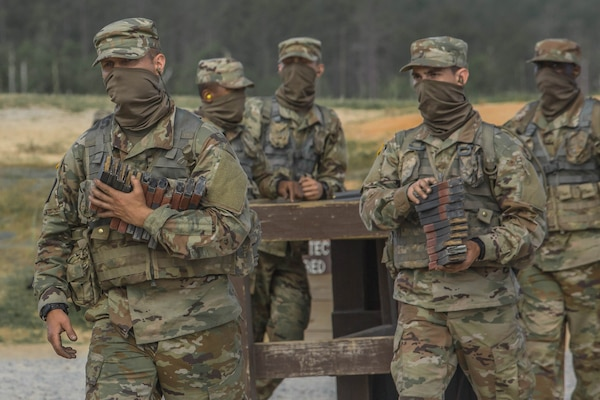 Soldiers in initial military training at Fort Jackson, South Carolina, carry ammunition, May 11, 2020.