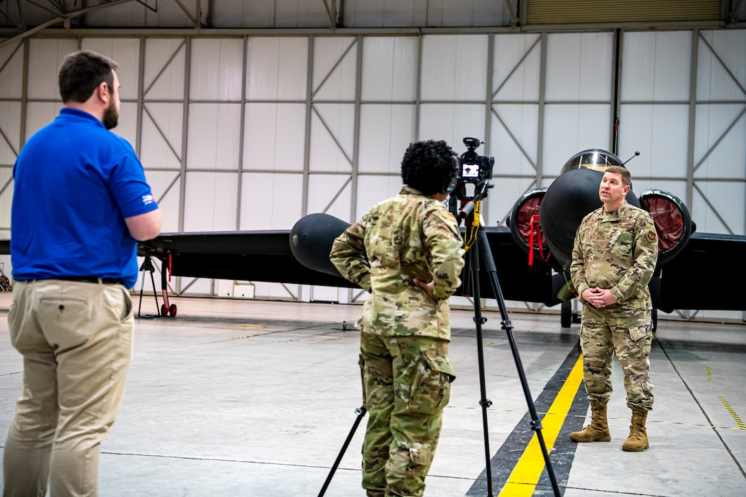 U.S. Air Force Col. Kurt A. Wendt, right, 501st Combat Support Wing commander, performs a video interview in a hangar at RAF Fairford, England, July 7, 2020. Wendt conducted the interview as part of the 2020 Virtual Royal International Air Tattoo. (U.S. Air Force photo by Senior Airman Eugene Oliver)