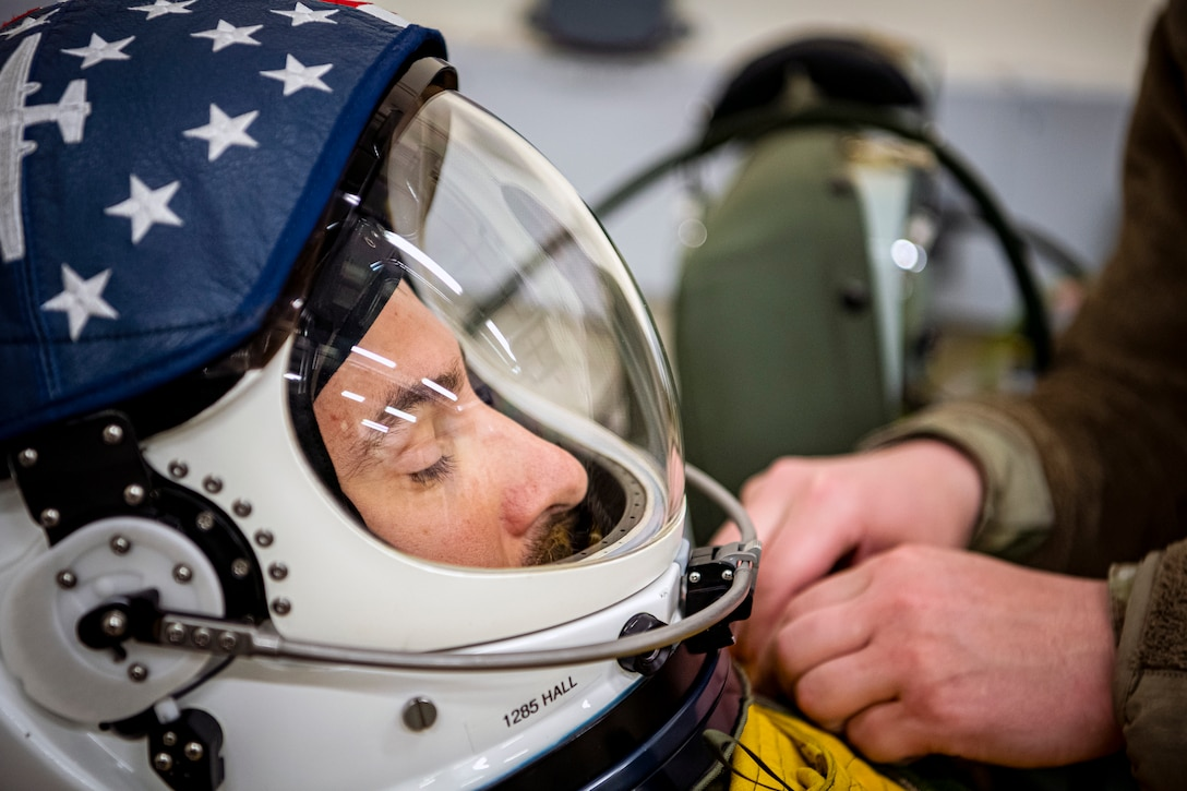 U.S. Air Force Capt. Joshua Hall, left, 99th Reconnaissance Squadron U-2 Dragon Lady pilot, receives suit preparations at RAF Fairford, England, July 8, 2020. The U-2 aircraft assigned to the 9th Reconnaissance Wing, Beale Air Force Base, Calif., are currently deployed to RAF Fairford as part of the 99th Expeditionary Reconnaissance Squadron. The aircraft supplements a variety of missions that enhance regional and global security support in support of U.S. and NATO allies and regional partners. (U.S. Air Force photo by Senior Airman Eugene Oliver)