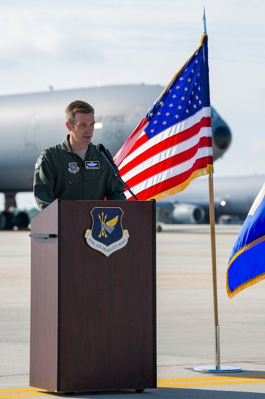 U.S. Air Force Col. Scott Wiederholt, 305th Air Mobility Wing commander, speaks to guests at a July 13 ceremony at Joint Base McGuire-Dix-Lakehurst, N.J., which marked the first retirement of 59 Extenders intended for eventual replacement by the KC-46A Pegasus. As the first of three KC-10s from the Air Force's Backup-Aircraft Inventory congressionally approved for retirement during Fiscal Year 2020, Extender #86-0036, was flown to the 309th Aerospace Maintenance and Regeneration Group at Davis-Monthan Air Force Base, Ariz., where it will continue to support the remaining Extenders with parts as they are flown for several years while the KC-46A Pegasus is integrated into Air Mobility Command's Total Force tanker enterprise. For nearly four decades, KC-10s have helped secure global reach for America, providing in-flight refueling to U.S. and coalition aircraft, from Operations Desert Shield and Desert Storm to Operation Inherent Resolve. The KC-10 is flown from JBMDL by both the 305th AMW and its associate Air Force Reserve unit, the 514th AMW.