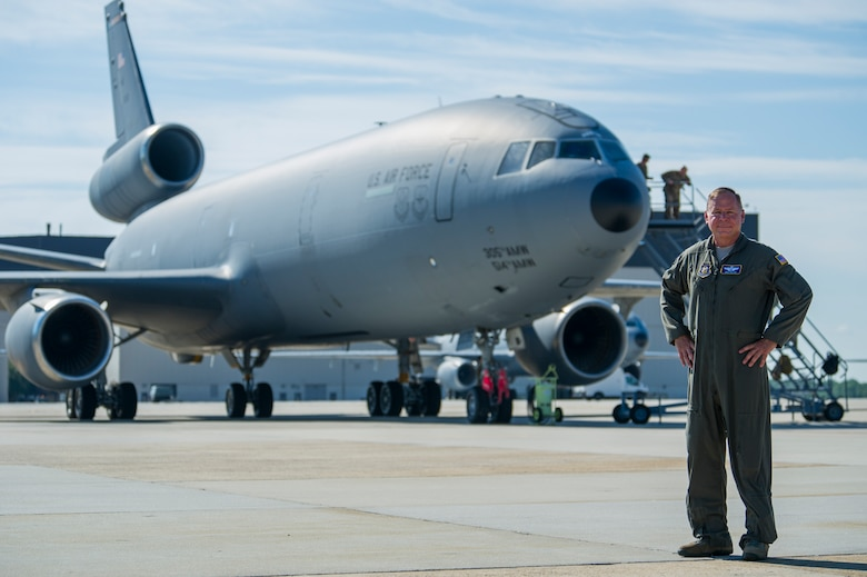 U.S. Air Force Lt. Col. Mike Pillion, an Air Force Reserve pilot from the 514th Air Mobility Wing at Joint Base McGuire-Dix-Lakehurst, N.J., proudly poses in front of KC-10 Extender #86-0036 prior to flying his final or fini-flight following the aircraft's ceremonious retirement at JBMDL on July 13. The first of three KC-10s from the Air Force's Backup-Aircraft Inventory congressional approved for retirement during Fiscal Year 2020, Pillion flew #86-0036's final mission to the 309th