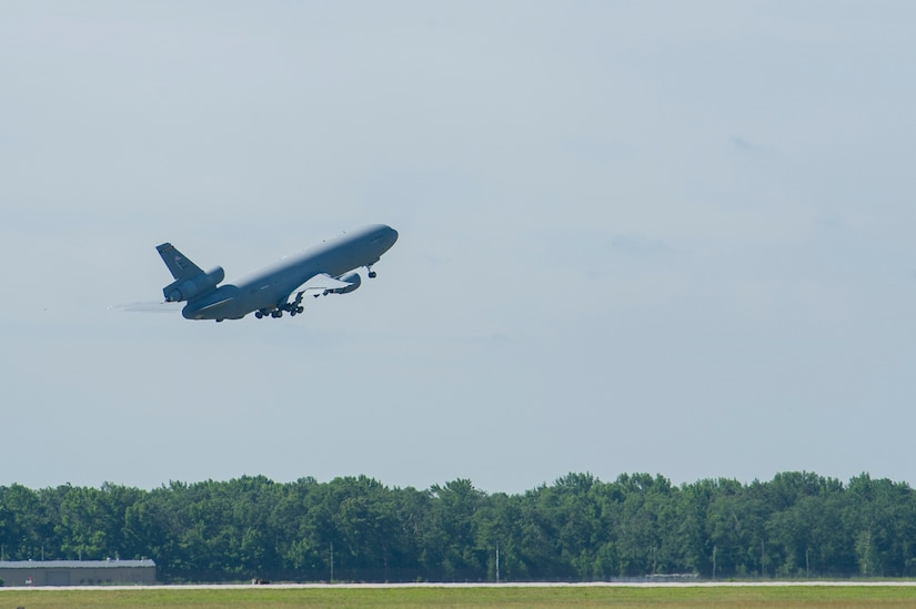 Photo of a KC-10 aircraft taking off.