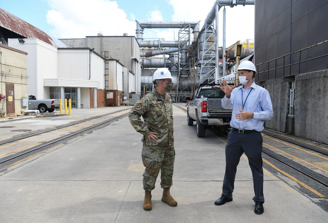 Dr. Rich Roberts, flight commander for store separation at Arnold Engineering Development Complex (AEDC), speaks with Chief Master Sgt. Stanley Cadell, command chief, Air Force Materiel Command, during a tour of the Propulsion Wind Tunnel Facility at Arnold Air Force Base, Tenn., headquarters of AEDC, July 8, 2020. In addition to briefings by AEDC personnel, Cadell and Gen. Arnold W. Bunch Jr., commander, Air Force Materiel Command, held discussions with leadership and team members on diversity and inclusion. (U.S. Air Force photo by Jill Pickett) (This image has been altered by obscuring items for security purposes.)