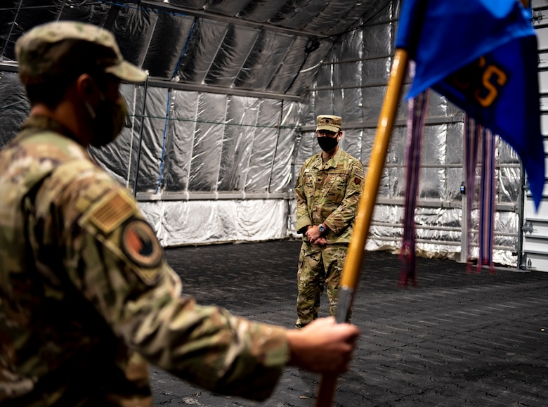 U.S. Air Force Master Sgt. John Reeves with the 81st Air Control Squadron stands at attention for U.S. Air Force Lt. Col. Steven Wyatt, 81st ACS commander, at Tyndall Air Force Base, Florida, July 8, 2020. Wyatt's change of ceremony was altered to fit Coronavirus Disease 2019 (COVID-19) guidance. Wyatt's first salute was scheduled after the official ceremony. (U.S. Air Force photo by Staff Sgt. Magen M. Reeves)