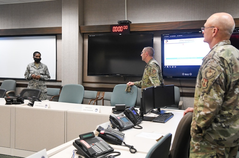 Master Sgt. Lashonda Morehead, left, flight chief of medical operations at Arnold Air Force Base, briefs Gen. Arnold W. Bunch Jr., right, commander, Air Force Materiel Command, and Chief Master Sgt. Stanley Cadell, command chief, Air Force Materiel Command, about the COVID-19 response at Arnold AFB, Tenn., headquarters of Arnold Engineering Development Complex, July 8, 2020. (U.S. Air Force photo by Jill Pickett)
