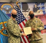 Establishing a legacy of success; Army Col. Frederic Maddox is awarded the Defense Superior Service Medal