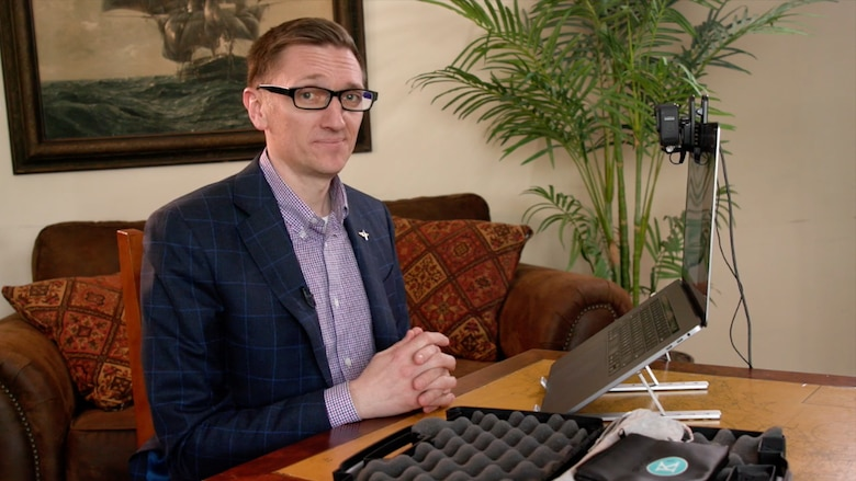 Ben Kimball in front of a computer with a camera attached