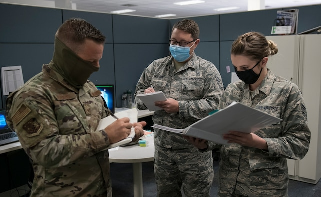 Master Sgt. Nathan Sigars, 419th Inspector General superintendent, reviews notes with personnel from the Education and Training Flight during a no-notice inspection