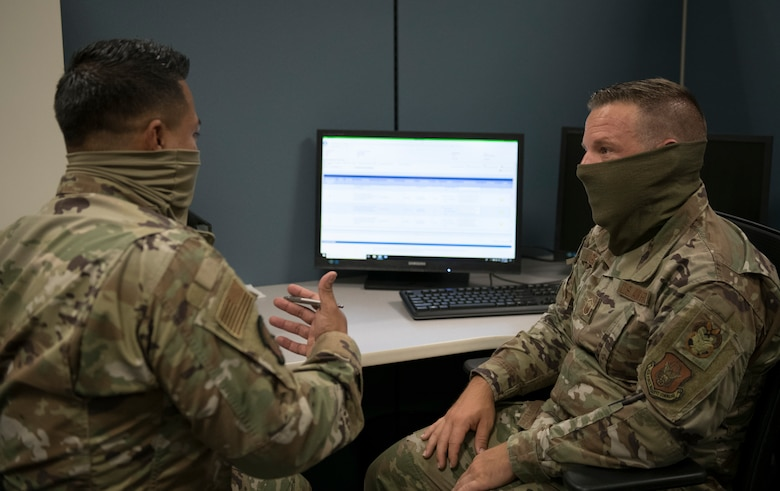 Master Sgt. Nathan Sigars, 419th Inspector General superintendent, instructs Tech. Sgt. Luis Choto, 419th Logistics Readiness Squadron, on different aspects of the Management Internal Control Toolkit