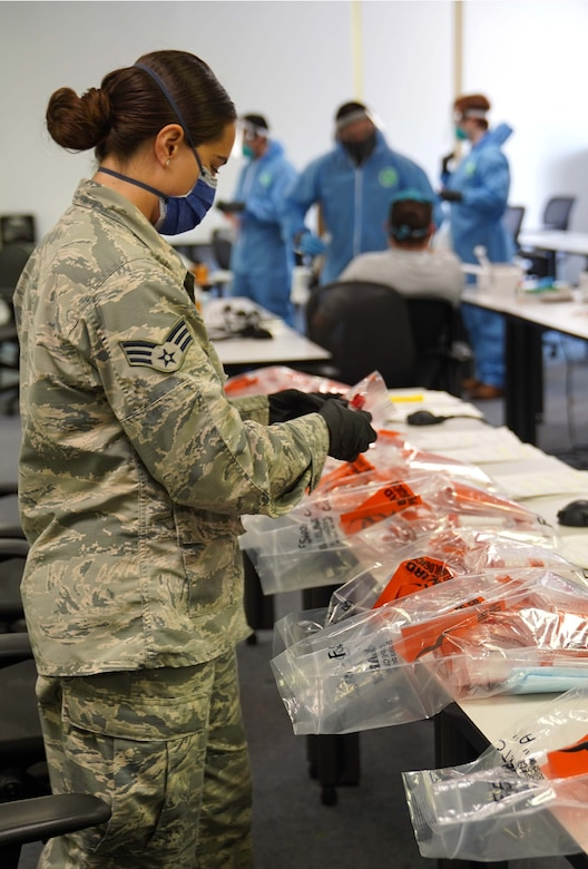 U.S. Air Force Senior Airman Brook Lee, 81st Diagnostic and Therapeutics Squadron laboratory technician, organizes samples for COVID-19 testing at the Combat Readiness Training Center in Gulfport, Mississippi, July 14, 2020. Airmen from Keesler Air Force Base assisted in testing over 900 Sailors as a part of the joint and total force effort across Navy and Air Force active duty and guard installations along the Gulf Coast. (U.S. Air Force photo by Airman 1st Class Kimberly L. Mueller)