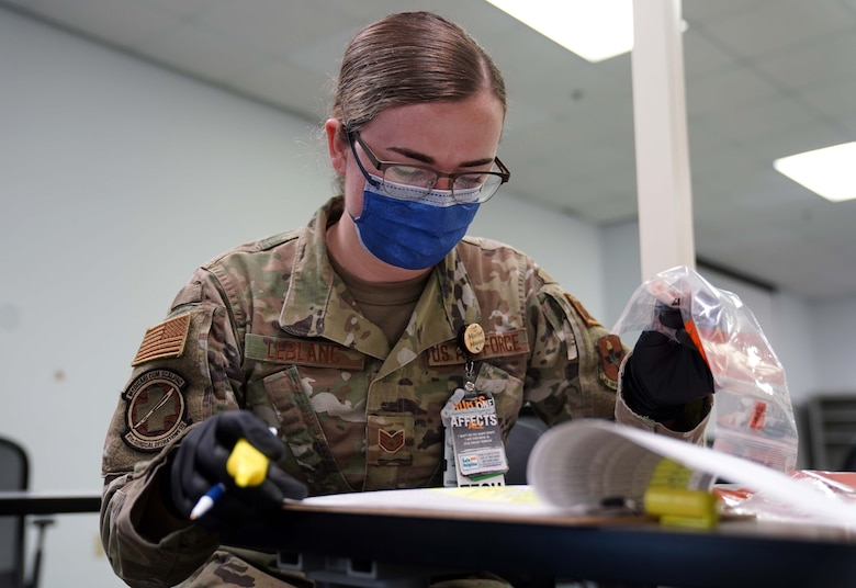 U.S. Air Force Staff Sgt. Taylor Leblanc, 81st Surgical Operations Squadron medical technician, records samples taken for COVID-19 testing at the Combat Readiness Training Center in Gulfport, Mississippi, July 14, 2020. Airmen from Keesler Air Force Base assisted in testing over 900 Sailors as a part of the joint and total force effort across Navy and Air Force active duty and guard installations along the Gulf Coast. (U.S. Air Force photo by Airman 1st Class Kimberly L. Mueller)