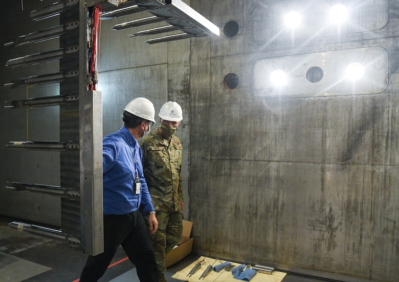 Scott Meredith, left, technical advisor for Arnold Engineering Development Complex (AEDC) Flight Systems Branch, and Chief Master Sgt. Stanley Cadell, command chief, Air Force Materiel Command, walk past a rake installed in a test section of the 16-foot supersonic wind tunnel, which is used to characterize the flow in the tunnel, during a tour July 8, 2020, at Arnold Air Force Base, Tenn., headquarters of AEDC. The visit to the Base by Cadell and Gen. Arnold W. Bunch Jr., commander, Air Force Materiel Command, focused on COVID-19 response, and diversity and inclusion. (U.S. Air Force photo by Jill Pickett) (This image has been altered by obscuring a badge for security purposes.)