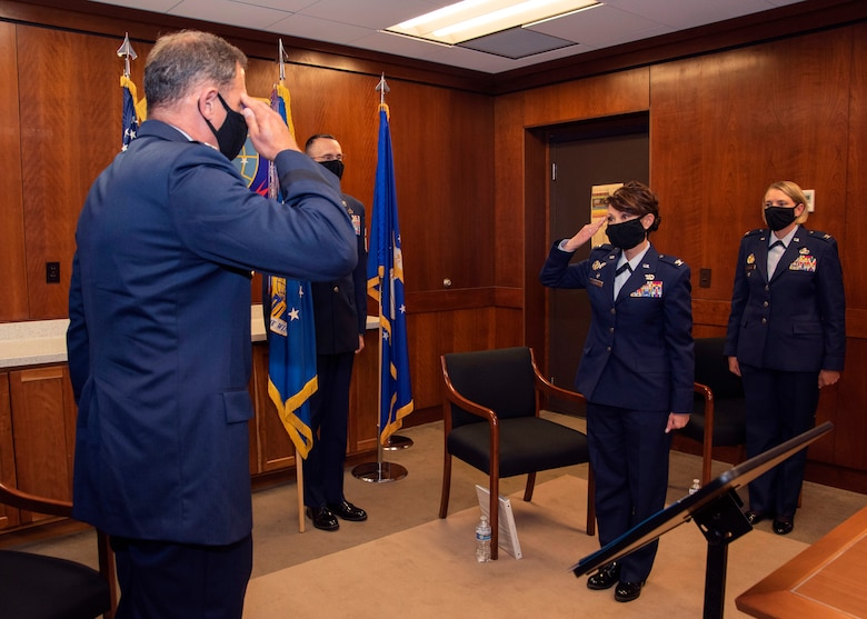 U.S. Air Force Col. Patricia Csànk relinquishes command of the 673d Air Base Wing during the change of command ceremony at Joint Base Elmendorf-Richardson, Alaska, July 14, 2020. The 673d ABW is composed of a command section, the 673d Comptroller Squadron, and four groups; the 673d Mission Support Group, the 673d Medical Group, 673d Civil Engineer Group, and the 673d Logistics Readiness Group. These are the primary organizations responsible for providing installation management functions to ensure JBER remains America's premier strategic power projection platform. The wing supports and enables three AF total-force wings, one Army brigade and 55 tenant units. The change of command ceremony was adapted to comply with COVID-19 health and safety measures.