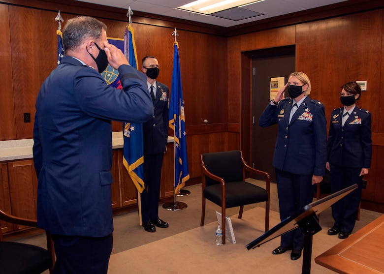 U.S. Air Force Col. Kirsten Aguilar assumes command of the 673d Air Base Wing during the change of command ceremony at Joint Base Elmendorf-Richardson, Alaska, July 14, 2020. The 673d ABW is composed of a command section, the 673d Comptroller Squadron, and four groups; the 673d Mission Support Group, the 673d Medical Group, 673d Civil Engineer Group, and the 673d Logistics Readiness Group. These are the primary organizations responsible for providing installation management functions to ensure JBER remains America's premier strategic power projection platform. The wing supports and enables three AF total-force wings, one Army brigade and 55 tenant units. The change of command ceremony was adapted to comply with COVID-19 health and safety measures.