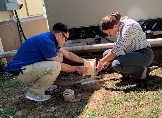 Special Agent Aramis Quinones-Tirado demonstrates the proper technique for casting a footprint for Agent Trainee 2nd Lt. Jessica Hotsko. (Courtesy photo)
