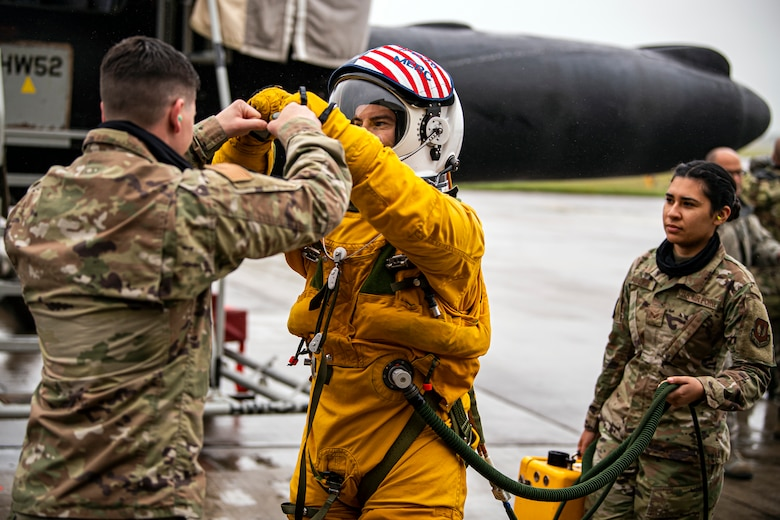 U.S. Air Force Capt. Joshua Hall, center, 99th Reconnaissance Squadron U-2 Dragon Lady pilot, fist bumps an Airman from the 99th Expeditionary Reconnaissance Squadron prior to takeoff at RAF Fairford, July 8, 2020. The U-2 aircraft assigned to the 9th Reconnaissance Wing, Beale Air Force Base, Calif., are currently deployed to RAF Fairford as part of the 99th ERS. The aircraft supplements a variety of missions that enhance regional and global security in support of U.S. and NATO allies and regional partners. The U.S. Air Force is engaged, postured and ready with credible force to assure, deter and defend in an increasingly complex security environment. (U.S. Air Force photo by Senior Airman Eugene Oliver)