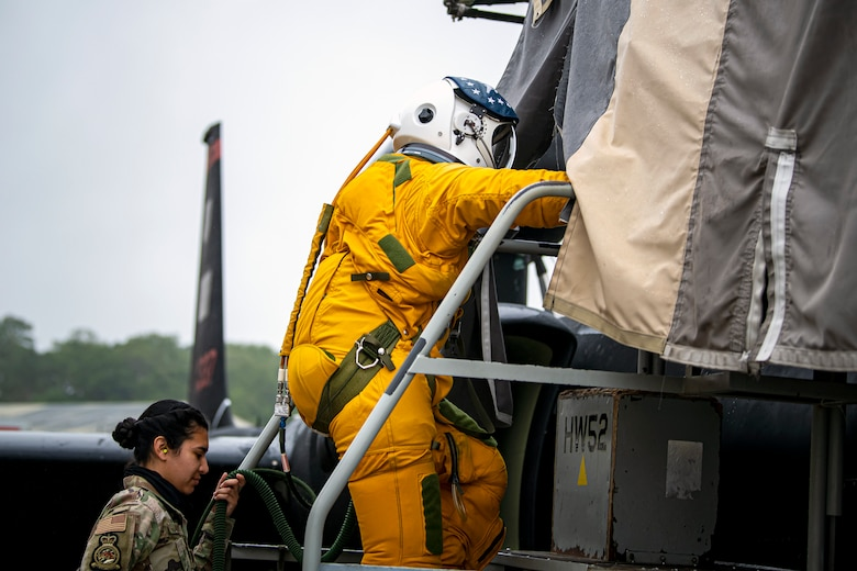 U.S. Air Force Capt. Joshua Hall, right, 99th Reconnaissance Squadron (ERS) U-2 Dragon Lady pilot, climbs into the cockpit of a U-2 aircraft while Senior Airman Cynthia Rivera, 99th ERS physiology support technician, helps transport his oxygen at RAF Fairford, England, July 8, 2020. The U-2 aircraft assigned to the 9th Reconnaissance Wing, Beale Air Force Base, Calif., are currently deployed to RAF Fairford as part of the 99th ERS. The aircraft supplements a variety of missions that enhance regional and global security in support of U.S. and NATO allies and regional partners. (U.S. Air Force photo by Senior Airman Eugene Oliver)