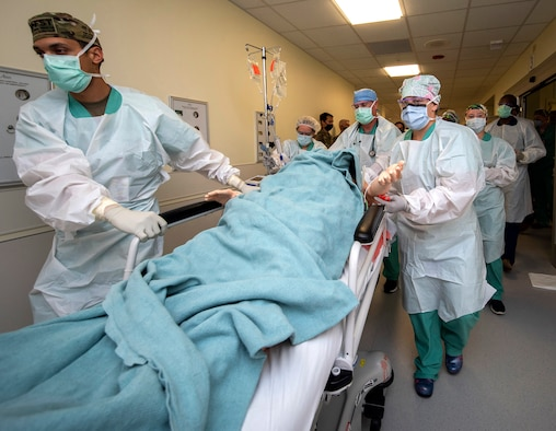 Members of the 555th Forward Surgical Team rush a simulated trauma patient to surgery during training with the Strategic Trauma Readiness Center of San Antonio, or STaRC, at Brooke Army Medical Center.