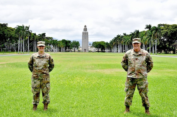 First Lt. Arielle Heald, 15th Wing Legal Office assistant staff advocate, and Capt. Christopher Piha, Pacific Air Forces weapons system support branch chief, along with U.S. Army Spc. Cantrell, not pictured, rendered first aid to a Honolulu Police officer who was involved in a motorcycle crash at Joint Base Pearl Harbor-Hickam, Hawaii, July 9, 2020. The officer is recovering from her injuries. (U.S. Air Force photo by 2nd Lt. Benjamin Aronson)