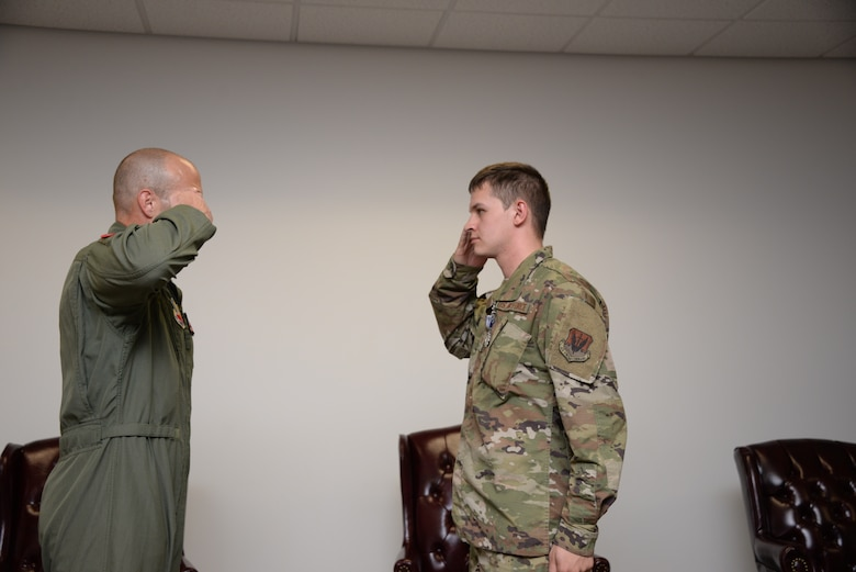 A photo of an Airman receiving a Purple Heart during a ceremony