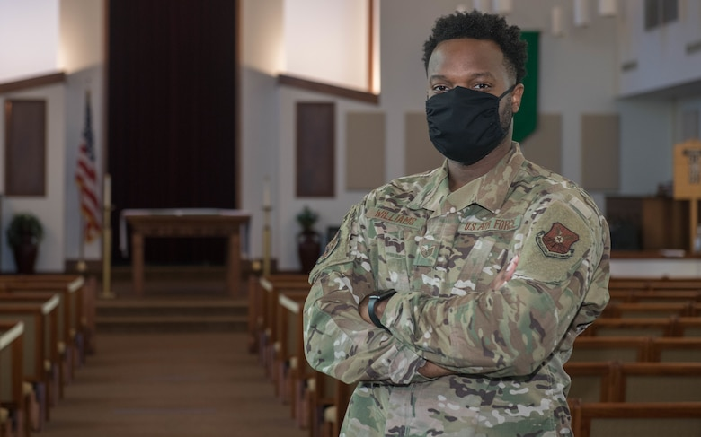U.S. Air Force Tech. Sgt. Terrence Williams, a 509th Bomb Wing religious affairs Airman, poses in the Spirit Chapel sanctuary at Whiteman Air Force base, Missouri, July 7, 2020. Religious Affairs Airmen work with Chaplains to provide confidential counseling and support for religious needs and services. (U.S. Air Force Photo by Senior Airman Thomas Johns.)