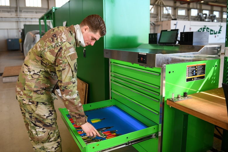 U.S. Air Force Staff Sgt. Edward T. Sims, 31st Aircraft Maintenance Squadron, 56th Helicopter Maintenance Unit support craftsman, opens an automated tool control system at Aviano Air Base, Italy, July 14, 2020. The 56th HMU renovated one of the hangars with new equipment. (U.S. Air Force photo by Airman 1st Class Ericka A. Woolever)