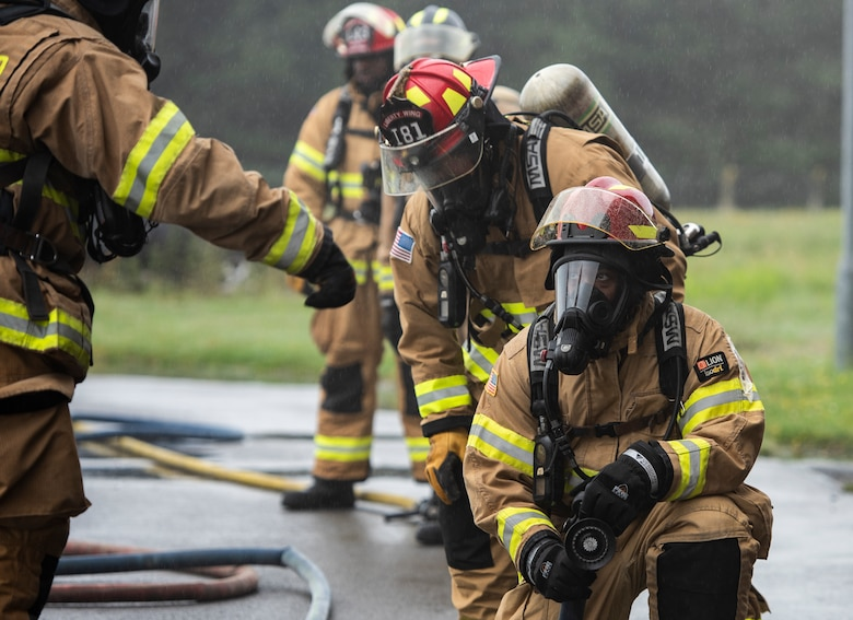 U.S. Air Force firefighters assigned to the 48th Civil Engineering Squadron prepare to participate in a controlled burn training exercise at Royal Air Force Lakenheath, England, July 8, 2020. Liberty wing firefighters participate in live fire and smoke training quarterly to ensure readiness for real-world situations. (U.S. Air Force photo by Airman 1st Class Jessi Monte)