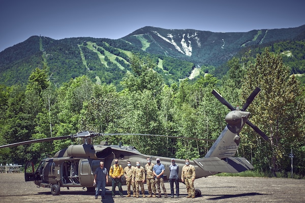 Aviators assigned to the New York Army National Guard's Army Aviation Support Facility #3, from Latham, N.Y., along with forest rangers and environmental conservation officers, scout locations for landing zones around Whiteface Mountain near Lake Placid, N.Y., July 6, 2020. The pilots are looking at using the rocky outcrops of the mountain to train with UH-60 Black Hawks helicopters.