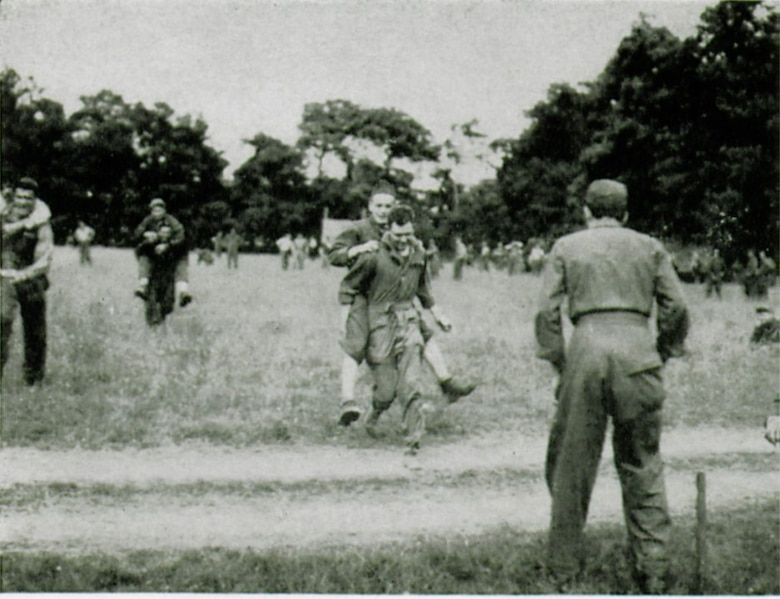 A piggy back race was part of the sports activities at the group's first birthday celebration at ALG A-6 near Sainte-Mère-Église.  (The Story of the 371st Fighter Group in the E.T.O.)