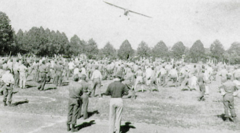 A Piper L-4 liaison aircraft cruised over the second birthday crowd at the sport-platz – if you caught a baseball dropped from the plane it was worth $10.00! (The Story of the 371st Fighter Group in the E.T.O.)
