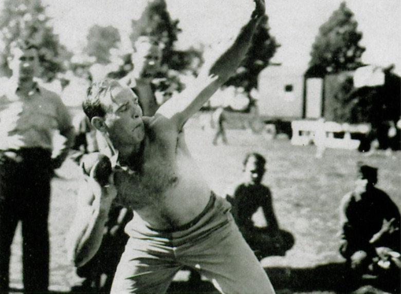 """The """"body beautiful"""" shown here in action during the group's second anniversary track and field meet. (The Story of the 371st Fighter Group in the E.T.O.)"""