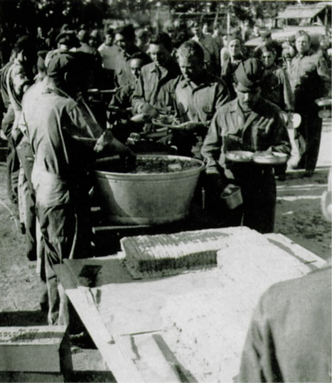 Barbecued chicken, potato salad, tomatoes and a birthday cake served as the fare on the group's second anniversary (The Story of the 371st Fighter Group in the E.T.O.)