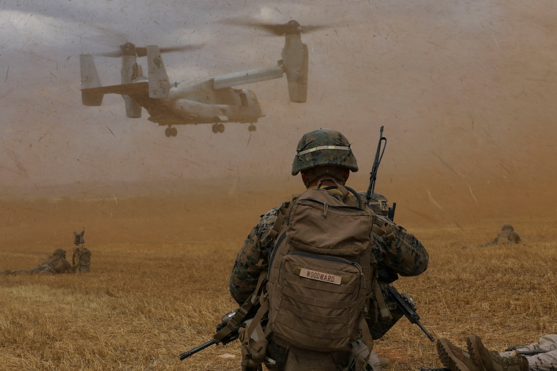 A U.S. Marine watches an MV-22B Osprey land at a landing zone during a tactical recovery of aircraft and personnel in Albacete, Spain, July 9.