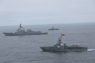 The Ecuadorian Navy corvette BAE Manabi and BAE Lojo conduct a passing exercise with USS Halsey.