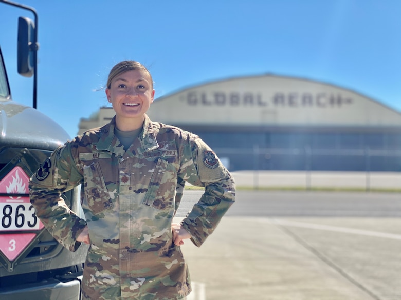 Maj. Tia Ahlf, 92nd Logistics Readiness Squadron commander, poses next to a fuels truck here, June 22, 2020. Ahlf took command of the 92nd LRS on June 11, 2020.