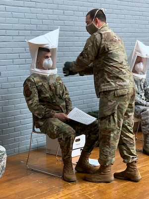 Air Force Master Sgt. Vitaliy Gorbachyk of the Connecticut Air National Guard gets fitted for a mask in preparation for a safety inspection at a long-term care facility in May 2020, Hartford, Connecticut. The inspections, which were part of Connecticut's COVID-19 pandemic response, were conducted by members of the Connecticut National Guard and DPH surveyors.