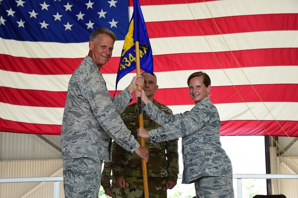 Col. Arianne Mayberry, 434th Maintenance Group commander, receives the guidon from Col. Larry Shaw, 434th Air Refueling Wing commander, during a change of command ceremony at Grissom Air Reserve Base, Indiana July 9, 2020. (U.S. Air Force photo/SSgt. Chris Massey)