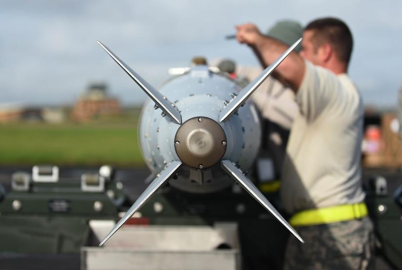 An airman works on a munition.