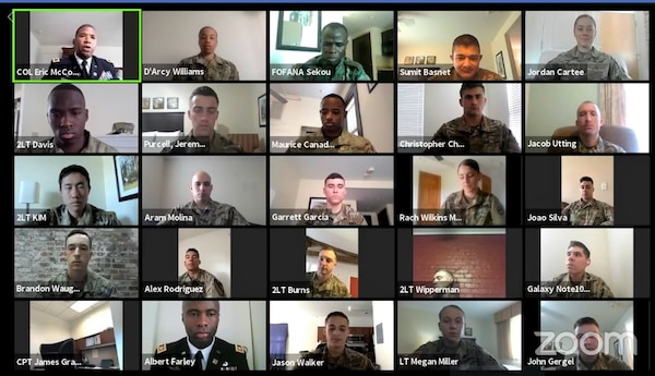 Army Soldiers participate in a Zoom virtual graduation ceremony.
