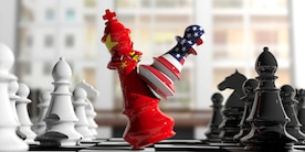 An American pawn assails a Chinese queen in a chess game