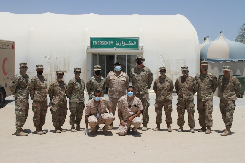Kuwaiti Soldiers stand with U.S. Army Soldiers of the 3rd Medical Command at a quarantine facility in Kuwait, July 3rd, 2020. U.S. and Kuwaiti forces have been working together to stop the spread of COVID-19 in Kuwait. (U.S. Army photo by Sgt. Andrew Valenza)