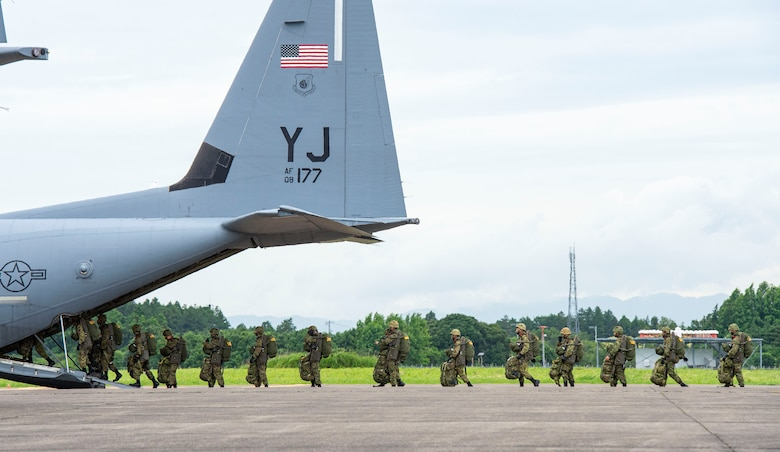 Japan Ground Self Defense Force paratroopers board a C-130J Super Hercules