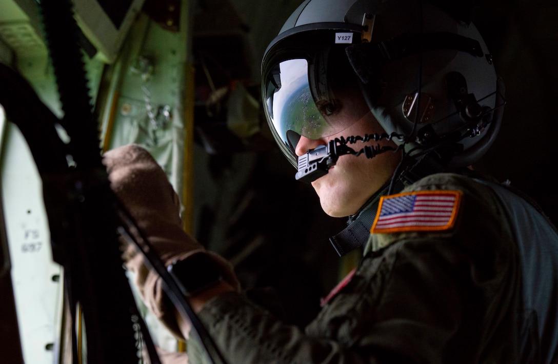 Senior Airman John Allum, 36th Airlift Squadron loadmaster, scans the terrain near the Ojoji drop zone
