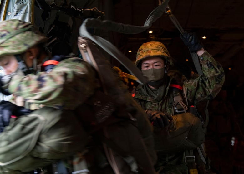 Japan Ground Self Defense Forces paratroopers jump out of a C-130J Super Hercules, assigned to the 374th Airlift Wing, Yokota Air Base