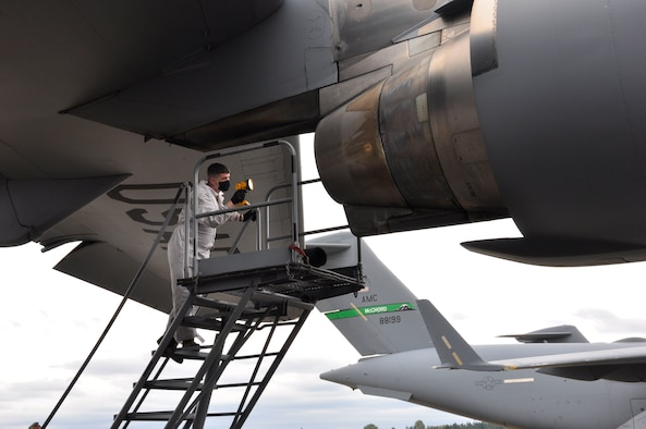 Airman inspect aircraft